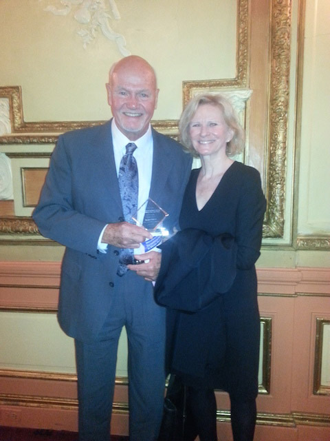 Kate Nace Day and Russ Murphy receiving the 2014 Exceptional Merit in Media Award of the National Women's Political Caucus
