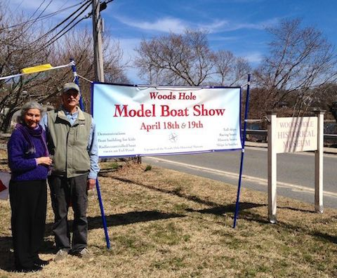 Getting Ready for the Woods Hole Model Boat Show! Woods Hole Museum Director Jennifer Gaines and Model Boat Show Committee member Tom Chilton pose next to the boat show sign in front of the museum.